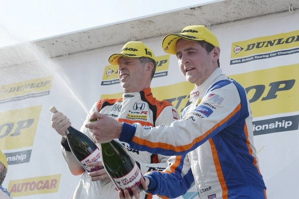 #25 Matt Neal and #600 Sam Tordoff celebrate on the podium after race three during the BTCC Oulton Park 4th-5th June 2016 at Oulton Park, Little Budworth, Cheshire, United Kingdom. June 05 2016. World Copyright Peter Taylor/PSP.