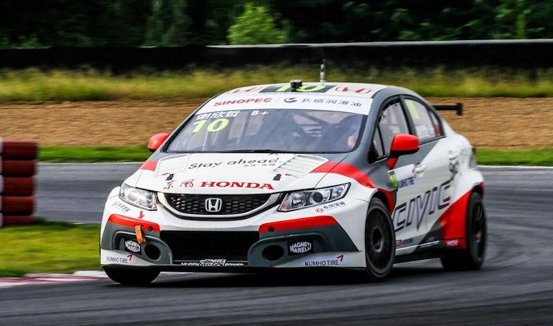Martin xie puts honda on pole in rain hit qualifying for Martin honda used cars